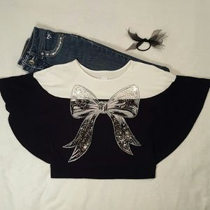 Justice top with sequin & glitter bow on front.